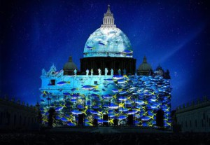 School of fish projected on St. Peter's Basilica. Photography by David Doubilet. Artistic rendering by Obscura Digital