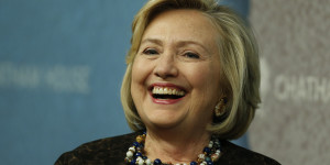 Former U.S. Secretary of State Hillary Clinton laughs as she arrives for an event at Chatham House in London, Friday, Oct. 11, 2013. Clinton is to be presented with the institute?s annual award in recognition of her contribution to the significant improvement of international relations, according to the institution. (AP Photo/Lefteris Pitarakis)