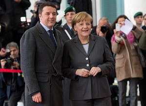 epa04130227 Italian Prime Minister Matteo Renzi (L) poses for the media as he is welcomed with military honors by German Chancellor Angela Merkel (R) during his inaugural official visit in Berlin, Germany, 17 March 2014. Merkel and new Italian Prime Minister Matteo Renzi along with members of their respective cabinets held talks in Berlin after Merkel greeted her Italian guest with military honours at the chancellery. EPA/Bernd Von Jutrczenka